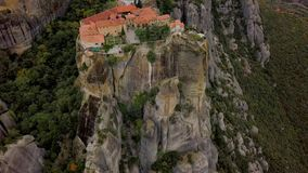 Flight over the rock formations and monasteries of Meteora, Greece. Beautiful aerial survey over the rock formations and monasteries of Meteora, Greece stock video