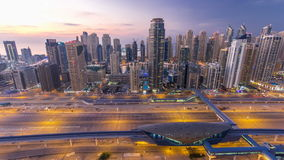 Beautiful aerial top view day to night timelapse of Dubai Marina and JLT in Dubai, UAE stock video footage