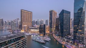Beautiful aerial top view day to night transition timelapse of Dubai Marina canal. Beautiful aerial top view day to night transition timelapse of all Dubai stock footage