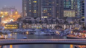 Beautiful aerial top view day to night transition timelapse of Dubai Marina canal. Aerial top view day to night transition timelapse of Dubai Marina promenade stock footage