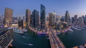 Beautiful aerial top view day to night transition timelapse of Dubai Marina canal. Beautiful aerial top view day to night transition timelapse of all Dubai stock video footage