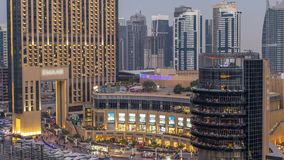 Beautiful aerial top view day to night transition timelapse of Dubai Marina canal. Beautiful aerial top view day to night transition timelapse of mall and stock footage