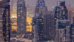 Beautiful aerial top view day to night transition timelapse of Dubai Marina. After sunset in Dubai, UAE. Modern towers and traffic on the road stock video footage