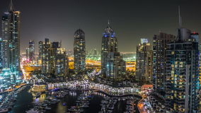 Beautiful aerial top view at night timelapse of Dubai Marina in Dubai, UAE stock footage