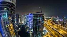 Beautiful aerial top view at night timelapse of Dubai Marina and JLT in Dubai, UAE. Beautiful aerial top view at night timelapse of Dubai Marina  and JLT stock video