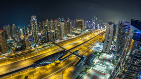 Beautiful aerial top view at night timelapse of Dubai Marina and JLT in Dubai, UAE stock footage
