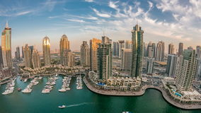 Beautiful aerial top view at sunset timelapse of Dubai Marina in Dubai, UAE. Beautiful aerial  top view at sunset timelapse of Dubai Marina promenade and canal stock footage