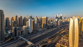 Beautiful aerial top view at sunset timelapse of Dubai Marina and JLT in Dubai, UAE stock video