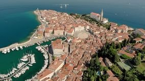 Beautiful aerial video of Piran town with Tartini main square, ancient buildings with red roofs and Adriatic sea in. Beautiful aerial footage of Piran town with stock video footage