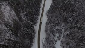 Beautiful aerial view above the winter road. 4k stock video footage