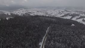 Beautiful aerial view above the winter road. 4k stock footage