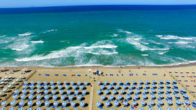 Beautiful aerial view of beach chairs and umbrellas along the oc Royalty Free Stock Photo