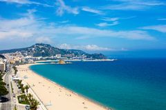 Beautiful view of beach and town Blanes, Costa Brava, Catalonia,. Beautiful aerial view of beach and town Blanes, Costa Brava, Catalonia, Spain - May 23, 2018 Stock Image