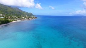 Beautiful aerial view of the beach, Indian Ocean and Mountains 4, Seychelles. Beautiful aerial view of the Beau Vallon beach, Indian Ocean and Mountains stock video footage