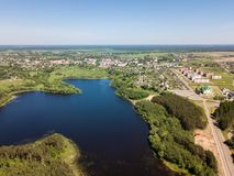 Beautiful aerial view of blue lake and green forest district in. Belarus royalty free stock image