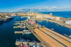 Beautiful aerial view of boats anchored in the port in of the city of Barcelona. Spain, beautiful day with a blue sky and white clouds, travel and adventure stock image