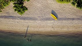 Aerial view of canoe and people on beach. Beautiful aerial view of a canoe and people swimming on white beach sand in Labuan Bajo at Flores Island near Bali stock video