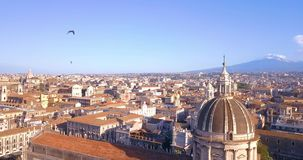Beautiful aerial view of the Catania city with main Cathedral and Etna. Beautiful aerial view of the Catania city with main Cathedral and Etna volcano on the stock video footage