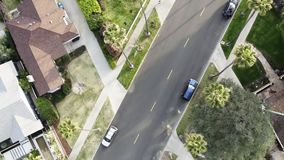 A beautiful aerial view of a classical American middle and upper-class neighborhood with single family housing, lawns stock video footage