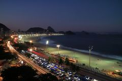 Beautiful aerial view of Copacabana Beach and Sugar Loaf mountain in distance by night, Rio de Janeiro, Brazil royalty free stock images