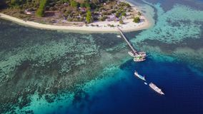 Beautiful aerial view of Kanawa Island. Beautiful aerial view footage jetty, boats, and turquoise water at Kanawa Island close to  Bali, Indonesia. Shot in 4k stock footage