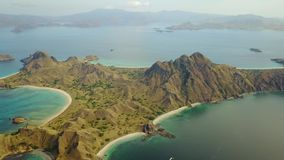 Aerial view of Padar Island. Beautiful aerial view footage of Padar Island with white sand beach, turquoise sea water, and savanna hills, an island located near stock video footage