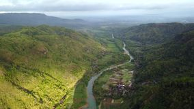 Aerial view of river in Panguk Hill valley stock video footage