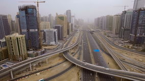 Beautiful aerial view of futuristic city landscape with roads, cars, trains, skyscrapers. Dubai, UAE stock footage
