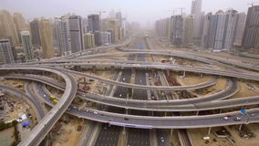 Beautiful aerial view of futuristic city landscape with roads, cars, trains, skyscrapers. Dubai, UAE stock video