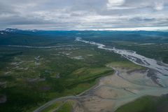 Beautiful aerial view of Katmai National Park. Braided river and untouched wilderness, and mountains in Alaska. View from a bush plane royalty free stock photos
