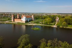 Beautiful aerial view of Medieval Mir castle complex on sunny sp. Ring day. Famous landmark, UNESCO world heritage royalty free stock images