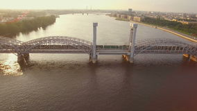Beautiful aerial view of the railway bridge across the river stock video footage