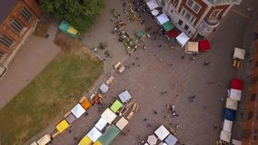Beautiful aerial view of the Riga old town. Main square Dome square with local market and people preparing for national `Ligo` celebration event stock video