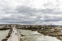 Beautiful aerial view of the river Guadalquivir river and the Roman bridge of Cordoba with the city in the background royalty free stock photography