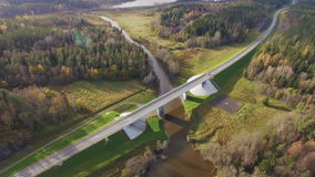 Beautiful aerial view of road bridge over the river surrounded by forest. It is located in the Republic of Karelia. On the bridge one lane in each direction stock video