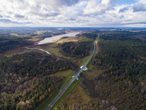 Beautiful aerial view of road bridge over the river surrounded by forest Royalty Free Stock Photography