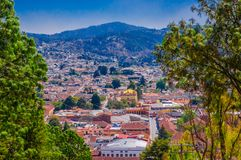 Beautiful aerial view of the rooftops of the old colonial buildings in the city of san cristobal de las Casas, during a. Gorgeous sunny day in Mexico royalty free stock image