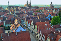 Beautiful Aerial View at Rothenburg ob der Tauber. Aerial view of some beautiful buildings and half-timbered buildings with gable roofs seen from the distance in Stock Photo