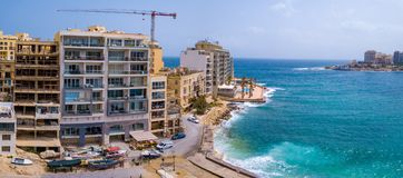 Spinola Bay, St. Julians and Sliema town on Malta. Beautiful aerial view of the Spinola Bay, St. Julians and Sliema town on Malta Stock Photo