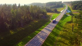 Beautiful aerial view of the truck, which rides on the highway in the forest stock footage