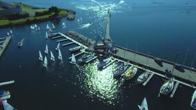 Beautiful aerial views of boats preparing for a sailing contest.