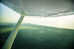A beautiful aero landscape looking out of a small plane window under the wing. Riga, Latvia, Europe in summer. Authentic flying ex. Perience in a sunny, hazy day royalty free stock image