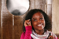 Beautiful african-america woman applying mascara Stock Photos