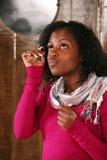 Beautiful african-america woman applying mascara Stock Photo