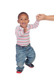 Beautiful African American baby learning to walk. Isolated on a white background stock photo