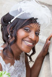 Beautiful african american bride portrait with veil over her face Stock Photography