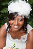 Beautiful african american bride posing in her wedding day with bouquet Stock Photo