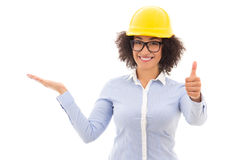 Beautiful african american business woman in builder helmet pres Stock Photos