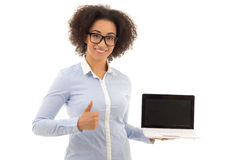 Beautiful african american business woman holding laptop with co Stock Photo