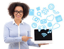 Beautiful african american business woman holding laptop with di Stock Photos